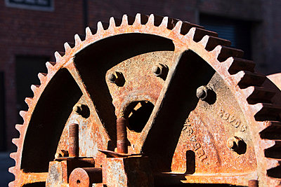 Close up detail of rusting cogwheel - p924m805844f by Ditto