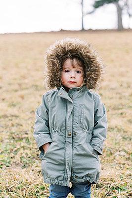 Two kids walking through a mowed meadow in winter. - p1166m2159506 by Cavan Images