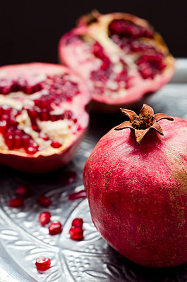 Pomegranates [Punica granatum] on silver tray - p300m873889f by Canan Czemmel
