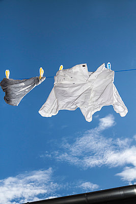 Clothes on a line - p739m815232 by Baertels
