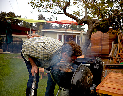 Man Barbecuing BBQ - p1260m1091955 by Ted Catanzaro