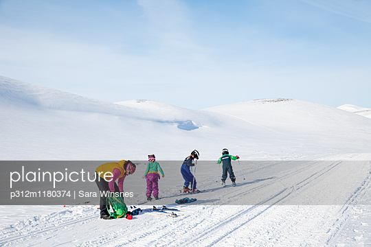 Mother with children skiing