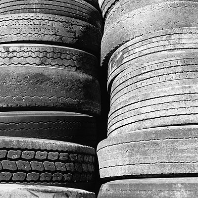 Close of a stack of discarded worn old automobile tyres, near Wendover in Utah. - p1100m876033f by Paul Edmondson