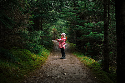 Girl enjoying walk in forest - p1166m2130825 by Cavan Images
