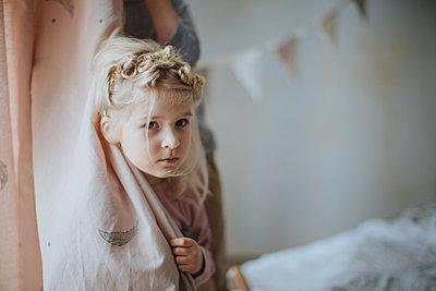 Girl hiding behind curtain - p1414m1590583 by Dasha Pears