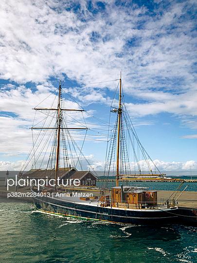 Sailing ship in Assens harbour - p382m2284013 by Anna Matzen