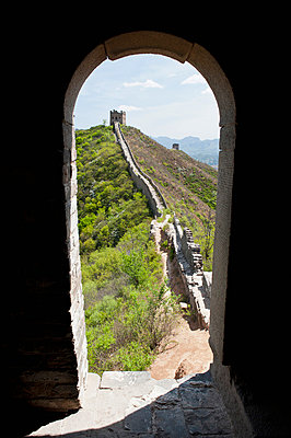 Great wall of China seen through arch - p30120144f by Mark Gerum