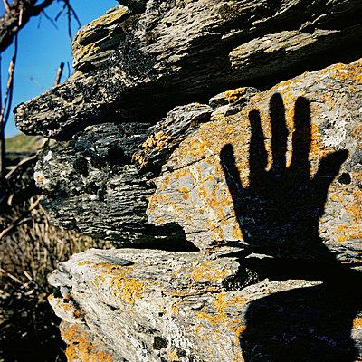 shadow of hand on stone (pyrenees)  - p5672660 by Sandrine Agosti-Navarri