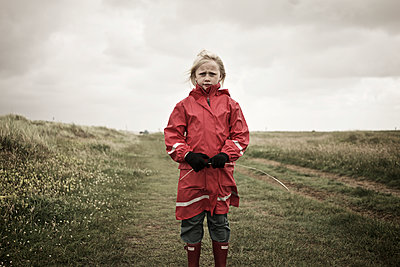 Girl on meadow - p312m1121675f by Henrik Kindgren