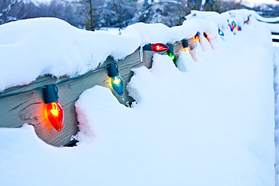 Christmas Lights on a Snowy Deck - p1166m2152081 by Cavan Images
