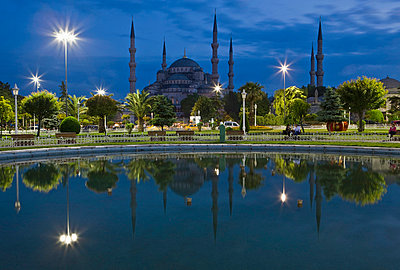 Blue Mosque in evening, reflected in pond, Sultanahmet Square, Istanbul, Turkey, Europe - p8712789 by Martin Child
