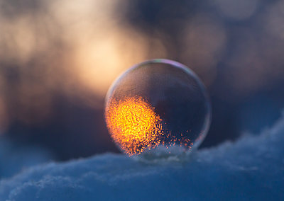 Soap bubble on the snow - p1251m1115439 by Heikki Tabell