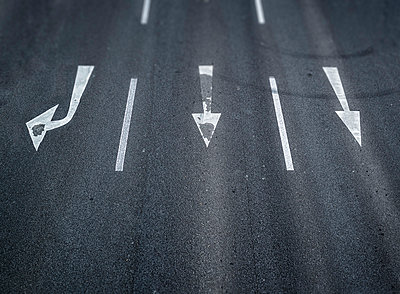 Arrow signs on a road - p300m983549f by Ophelia photography