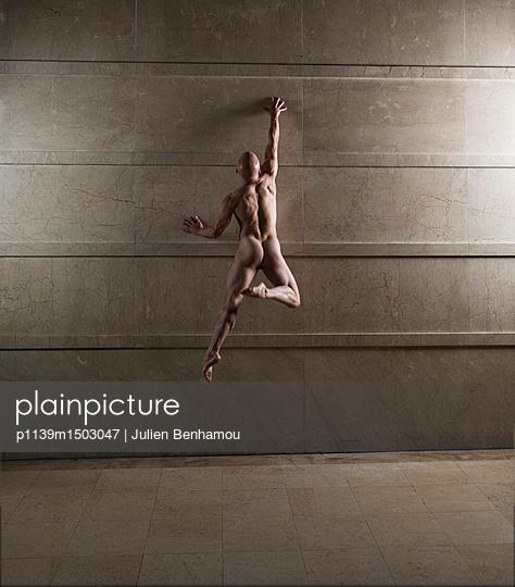 Naked man takes a leap - p1139m1503047 by Julien Benhamou
