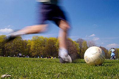 Playing football - p0810138d by Alexander Keller