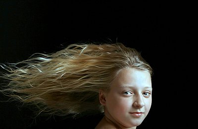 Girl with long blowing hair - p1019m2149522 by Stephen Carroll
