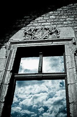 Reflection of clouds in a window glass - p1170m1477249 by Bjanka Kadic