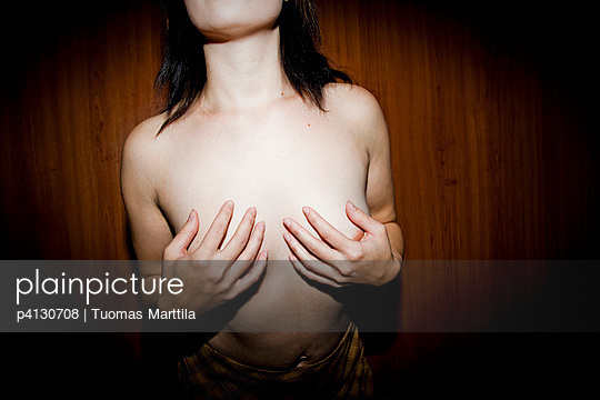 Woman holding her breast - p4130708 by Tuomas Marttila