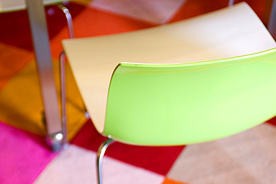 Modern Green Plastic Chair on Bright Rug - p5550257f by LOOK Photography