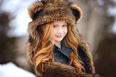 Young Girl Long Red Hair Wearing Bear Spirit Hood - p1166m2208462 by Cavan Images
