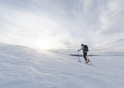 Skier skiing at sunny day - p312m1114120f by Stefan Isaksson