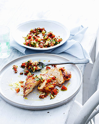 Plate of chicken with salsa - p429m1450716 by BRETT STEVENS
