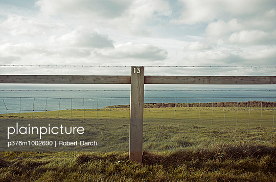 Numbered fence by sea - p378m1002690 by Robert Darch