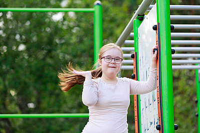 Smiling girl on playground looking at camera - p312m2216970 by Phia Bergdahl