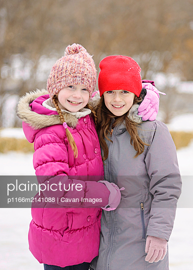 Two Friends Outside in Winter - p1166m2141088 by Cavan Images