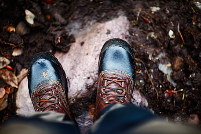 Sweden, Man in shiny boots standing - p352m1349140 by Fredrik Ottosson