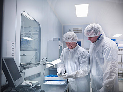 Scientists with product in clean room - p42912952f by Monty Rakusen