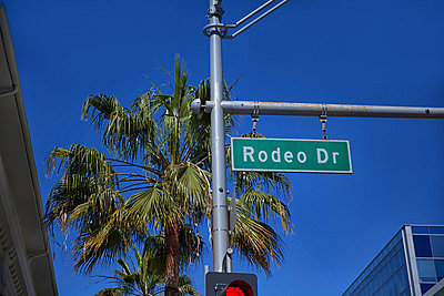 Rodeo Drive sign on traffic signal - p924m805884f by David Jakle