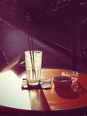 Empty glass on pavement cafe table - p1072m829377 by Neville Mountford-Hoare