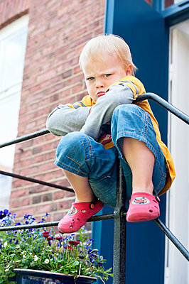 Sad boy hanging on railing - p312m1210987 by Rebecca Wallin