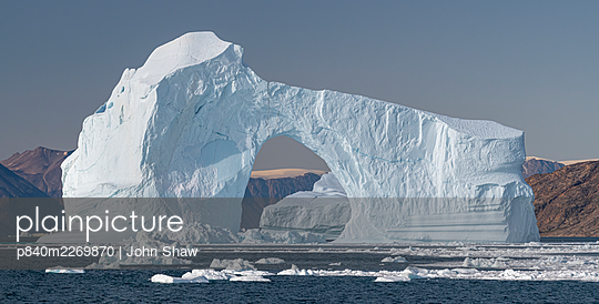 Iceberg with arch in Hall Bredning, Scoresby Sund, Greenland, August. - p840m2269870 by John Shaw