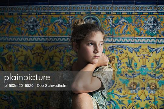 Girl Sitting Against Spanish Tile - p1503m2015920 by Deb Schwedhelm