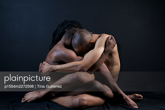 Two naked young men embracing - p1554m2272598 by Tina Gutierrez