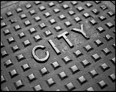 Manhole cover with the word city - p3720150 by Tom Maday