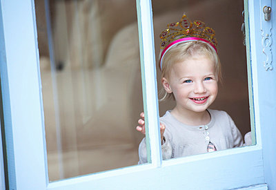 Smiling toddler girl wearing tiara - p42917523f by Ghislain & Marie David de Lossy