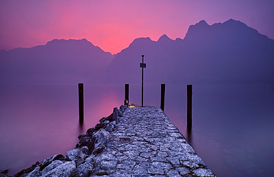 Italy, Torbole, Lake Garda, jetty at sunset - p300m2083768 by Michael Reusse (alt)
