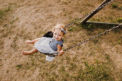 Cute little girl on  a swing - p300m2206971 by Sara Monika