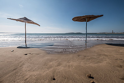 Parasols on the beach - p1243m1516492 by Archer