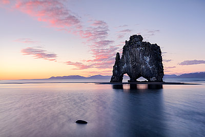 Hvtserkur, a dragon shaped rock in North West Iceland at sunset, around midnight in summer, Iceland, Polar Regions - p871m2058021 by James Kerwin