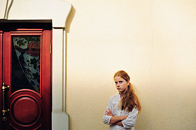 Blonde girl near red carved door - p1412m1573705 by Svetlana Shemeleva