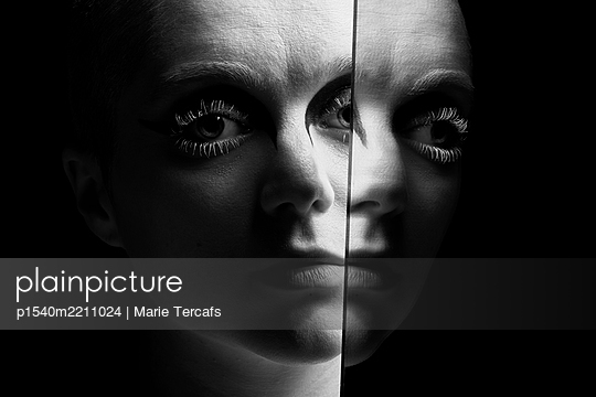 dramatic black and white portrait of an androgynous woman - p1540m2211024 by Marie Tercafs