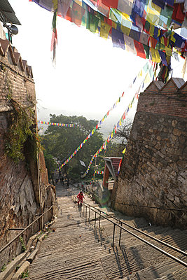 Swayambhunath stairs in early morning - p343m1218262 by Suzanne Stroeer