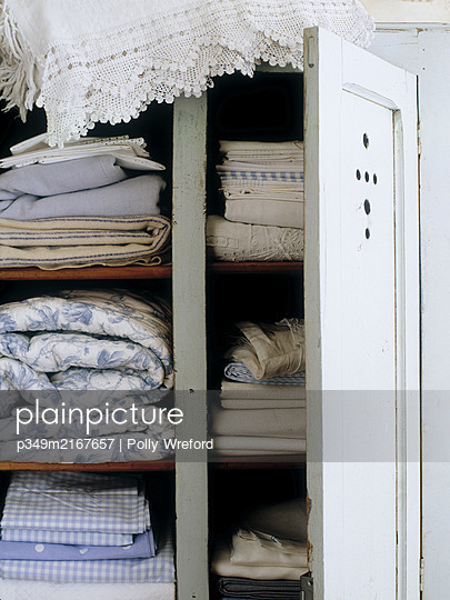 Folded bed linen and lace - p349m2167657 by Polly Wreford
