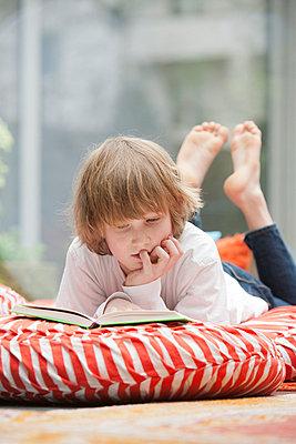 Reading boy - p9480049 by Sibylle Pietrek