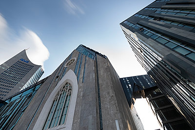 Germany, Leipzig, City-Hochhaus and university church seen from below - p300m2028933 by Christina Falkenberg