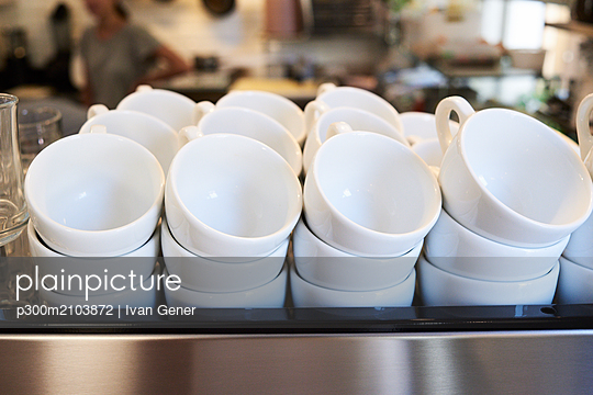 Lots of coffee cups in a cafe - p300m2103872 by Ivan Gener